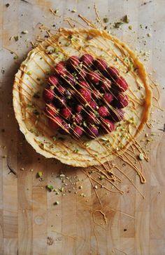 White Chocolate Tart with Fresh Raspberries, Pistachos & Caramelized White Chocolate   plumful
