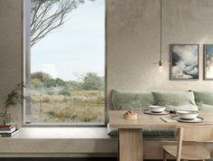 intérieur minimaliste, table à manger en bois, ampoule suspendue, murs en béton ciré