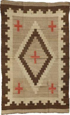 A NAVAJO REGIONAL RUG c. 1920 woven of native