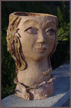 A flower pot, height 29cm. Sold.