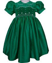 A truly magnificent dress,this Emerald green little girls silk smocked dress will soon become a favorite. It is smocked in the bodice and hand embroidered with cream flowers. Up to size 10
