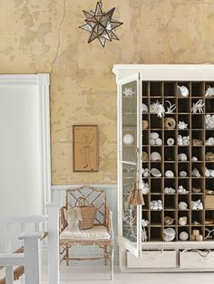 A 1930s cabinet—composed of 80 cubbies—hosts an array of natural objects: shells, nests, antlers, feathers. #storageideas