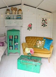 Summer House Ideas to Spruce Up Your Garden Amazing Pops of mustard and green. Also can we have that couch! The decoration of home is much like an exhibition space . Playhouse Decor, Playhouse Interior, Shed Interior, Room Interior, Beach Hut Interior, Small Summer House, Summer House Garden, Home And Garden Store, Summer Houses