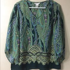 Flowy V Neck Top Free flowing v neck top in a size small.  3/4 length sleeves. Tops