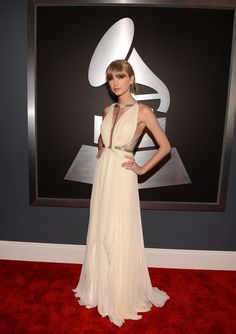 Taylor Swift chose a metallic-trimmed for the Grammys, cutout J. Mendel gown in a creamy white hue.