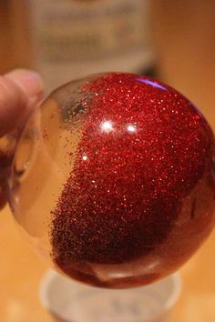 DIY Glitter Ornaments using pledge, glitter and clear ornaments - The glitter is on the inside - (beautiful!)