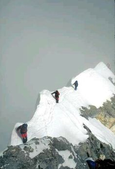 climbers descending the Everest summit.