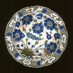 Maker: Unknown; pottery Category: fritware (stonepaste) Name(s): dish Islamic pottery; category Iznik; category Date: circa 1555 — 1560 School/Style: Ottoman Period: mid 16th century: