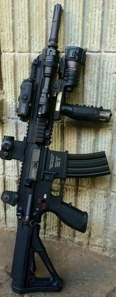 Check out this well equiped rifle from Heckler and Koch. With an awesome red dot sight and a comfortable stock this rifle is a dream to shoot. Guns And Ammo, Weapons Guns, Military Weapons, Military Life, Katana, Armas Sig Sauer, Survival, Fire Powers, Cool Guns