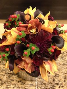 Fall Wedding Bridal Bouquet: Purple Callas, Purple Dahlias, Orange Orchids, Berries, Fiddlehead Ferns, and Tiny Burgundy Roses