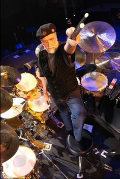 Mick Fleetwood- A master.  Holds the dubious distinction of being the only LIVING drummer on my list.  Probably also the tallest...