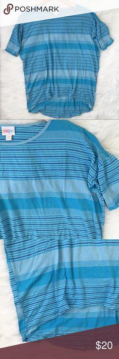 LuLaRoe Striped Blue Irma Shirt LuLaRoe blue striped Irma shirt. In very good condition.   ⭐️10% off 2+ bundle  ⭐️Size XXS ⭐️No stains or flaws ⭐️Item 27 LuLaRoe Tops Tees - Short Sleeve