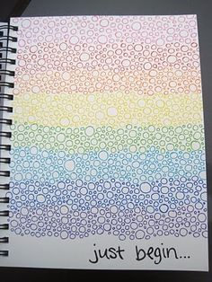 notebook with rainbow colored circles