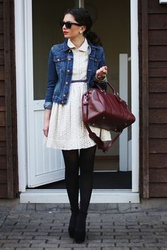 Ivory lace dress with black tights and jean jacket