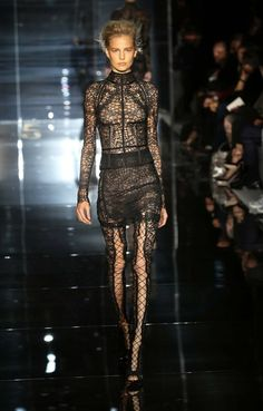 A model walks the runway at the Tom Ford show during the London Fashion Week for Spring/Summer 2014 in London.