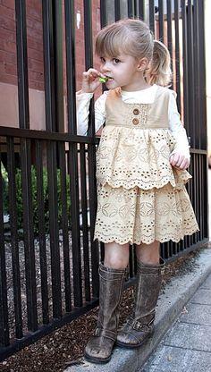 A cute little girl. love the little boots