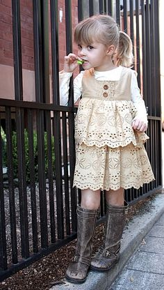 I wish I could buy this somewhere, but its made from an old skirt :-(  Em would look precious in it!  Love the boots too!