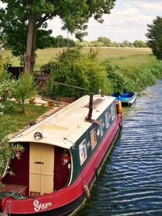 River Ouse, Cambridgeshire, England. would love to rent one of these canal boats