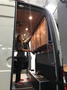 At Freedom Vans, we pride ourselves on our work. Our carpenter, Ken, just finished this beautiful stain of the Cascades for this van. Here is Tom, installing it. :) #freedomvans #stainedwood #woodart #travel #vanconversion #sprinter