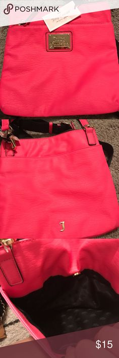 Neon pink Juicy Couture crossbody!✨ Super cute juicy could tour across body is a perfect accessory for any summer or spring day !!! Please be aware that there is a black little stain on the back I want to head and took a picture of it this back has never been used tags are still attached except for that little stain thank you so much💞 Juicy Couture Bags Crossbody Bags