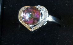 Sterling Silver Mystic Topaz  and White Sapphire  $35.00.  815-529-2263  sz 7 & 8
