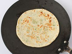 Paneer Kulcha is a delicious alternative for naan and tandoori roti and can be prepared at home. Learn how to make soft and delicious stuffed punjabi style paneer kulcha using tawa, tandoor and grill oven with this recipe.