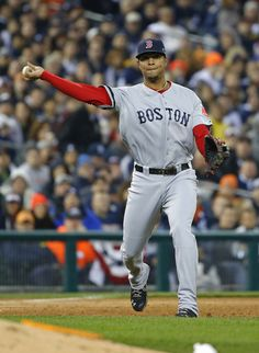 Boston Red Sox shortstop Xander Bogaerts throws out Detroit Tigers' Torii Hunter in the third inning during Game 5 of the American League ba...