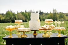 I like the idea of having the cake at the table with a couple of sweet treats versus a separate candy buffet.