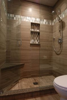 Porcelain athens gray tile for shower wall, 12 x 24 laid in alignment, shower floor is 6 x 6 athens gray, Cambria quartz on shower seat, curb, and niche shelves, frameless shower enclosure in clear glass