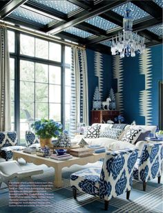 Nice mix of patterns in this blue and white room (via Rooms to Love / Gorgeous pattern play)