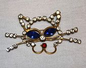 Vintage Rhinestone Feline Cat Brooch Blue White and Red stones gold plated
