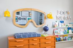 Upcycled baby changer in orange is literally looking hip and modern.