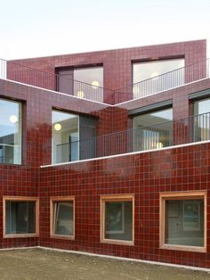 With their designs for a kindergarten in Merksem and a home for the elderly in Nevele, uses architecture not to conceal daily life but to situate it, in all its fragility, squarely at the centre of the urban stage. Brick Cladding, Brick Facade, Colour Architecture, Facade Architecture, Glazed Brick, Rest House, Building Facade, Brick And Stone, House Extensions