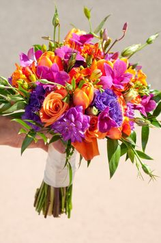 purple bright  wedding bouquet | Bright bridal bouquet in purple and orange by @Jim Campbell Flower | Fun