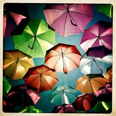 Colorful umbrellas in mid-air
