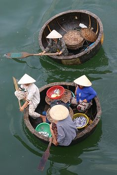 Ha Long Bay: Locals from the nearby villages will come up to our bamboo boats and motor boats to sell their goods.