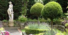 Secluded parterre garden with paths and walls made from reclaimed cobbles Back Gardens, Small Gardens, Outdoor Gardens, Diarmuid Gavin, Mediterranean Garden Design, Mediterranean Style, Roman Garden, Backyard Ideas For Small Yards, Backyard Designs
