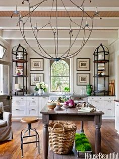That chandelier!  In Darryl Carter's kitchen -- House Beautiful