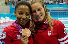 1st canadian medal of the 2012 Olympics! - Divers Jennifer Abel and Emilie Heymans, of Canada, celebrate their bronze medal following the Women's Syncronised 3m Springboard at the aquatic centre in London, England, Sunday, July 29, 2012.