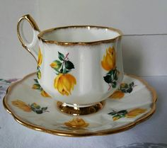 Good day my etsy friends ~ youve unveiled a treasure!! Discovered is a Beautiful Collectable Elegant Taylor and Kent Elizabethan Lovely Yellow Roses and Gold footed tea cup saucer set! Made in England. This divine set is full of brilliant colors of vibrant rich yellow paired with