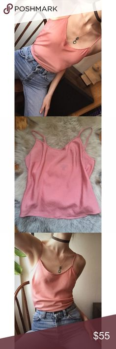 Baby Pink Silk Cami Size S Super cute and trendy baby pink silk Cami size small  Perfect to pair with your favorite vintage Levi's! Tag says 2P it will fit XS/S (I'm an XS for size reference) Small mark on the front that you can barely see, doesn't pick up in pictures, other than that, perfect quality! Not Ref. Cheaper offsite  Reformation Tops
