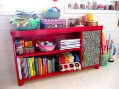 Something like this to organize all our homeschooling stuff. Our dining room is a disaster area, no organization. I like the pom poms in the canister. Have lots of those, need somewhere to put them.