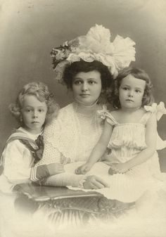 Edwardian family portrait, mother and two little children.