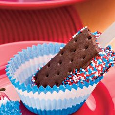 Easy way to show off the red white and blue at your July 4th party... ice cream sandwiches on a stick with sprinkles! #food #dessert