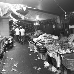 Narrow street with an typical underground market with fresh products - Shanghai