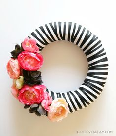 But cut strips of the ribbon so you get nice, lined-up stripes instead of overlapping. || Floral and Stripe Black and White Stripe Wreath on www.girllovesglam.com