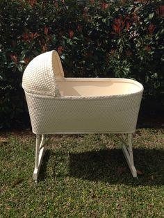 Vintage White Wicker Baby Bassinet 1970's. My mom bought me one at a garage sale and made a lace skirt to go around, it was very pretty.