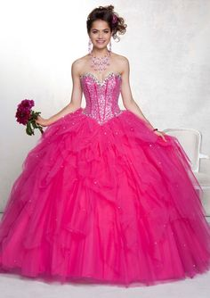 Long strapless fuchsia pink ball gown with silver rhinestone bodice accents & tiered tulle skirt from Vizcaya By Mori Lee (Style: 88049).