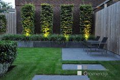 Strakke tuin met sfeervolle tuinverlichting in Vleuten