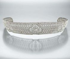 ART NOUVEAU TIARA IN PLATINUM AND DIAMONDS c1910 worked in openwork lace pattern…